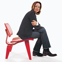 Woman sits in red chair