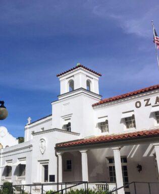 White Ozark bathhouse with blue sky
