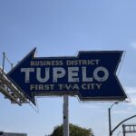 "neon arrow sign that says ""Tupelo"""